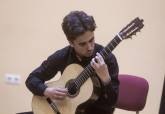 entre cuerdas y metales guitarra