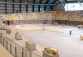 Instalación del nuevo parqué del Palacio de Deportes