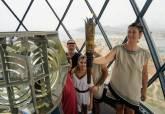 Encendido y traslado de las llamas de las fiestas en el faro de Cabo de Palos