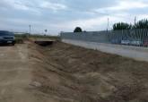 Obras de limpieza del canal de drenaje situado junto al instituto de La Palma