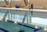 Últimos preparativos de la piscina del Palacio de Deportes.